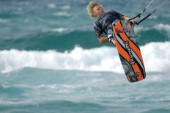 Kitesurfer in mid air in strong winds