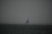 The Volvo Ocean Race fleet head head out to sea at the start of leg one from Vigo, Spain. BRAZIL under dark sky in stormy conditions