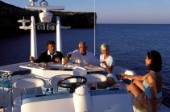 Male and female models relaxing and socialising on a luxury Fairline powerboat