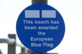 Sign stating that This beach has been awarded the European Blue Flag