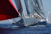 PORTO CERVO, SARDINIA - SEPT 6th 2006: The gigantic 37 metre maxi yacht Ghost (USA) owned by Arne Glimcher sets her huge red asymmetric spinnaker ahead of the Cruising Division fleet at the Maxi Yacht Rolex Cup 2006 in Porto Cervo, Sardinia. (Photo by Tim Wright/Kos Picture Source via Getty Images)