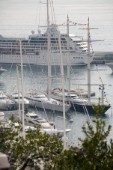 Mega yachts and superyachts moored in Monaco harbour, where cruise ships now also have berths