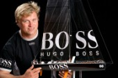 BILBAO, SPAIN - October 22nd 2006: Alex Thomson (GBR) skipper of Open 60 monohull HUGO BOSS with a model of his boat. The Velux 5 Oceans is a three part round the world yacht race for the bravest of solo sailors. Leg 1 is approximately 12,000 miles from Bilbao in Spain to Fremantle in Western Australia. It is the ultimate test of sailing skill, stamina and endurance. (Rights restrictions may apply)
