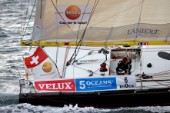 BILBAO, SPAIN - October 22nd 2006: Bernard Stamm (SUI), sailing onboard his Open 60ft Monohull  CHEMINƒES POUJOULAT. The Velux 5 Oceans is a three part round the world yacht race for the bravest of solo sailors. Leg 1 is approximately 12,000 miles from Bilbao in Spain to Fremantle in Western Australia. It is the ultimate test of sailing skill, stamina and endurance. (Rights restrictions may apply)