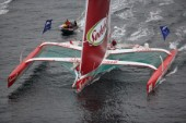 ST. MALO, FRANCE - OCTOBER 29th 2006: Thomas Colville (Fra) on his trimaran Sodebo starts the Route du Rhum. The Open 60 trimarans and monohull classes are watched by crowds of spectators as they start the Route du Rhum trans-atlantic race off St. Malo, France, on October 29th. The Route du Rhum is a challenging race for solo sailors which starts in St Malo and finishes in Pointe a Pitre, Guadeloupe. (Photo by Gilles Martin-Raget/Kos Picture Source via Getty Images)