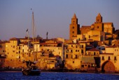 Cefalù - Sicily - Italy. The City seen from the sea at sunset.