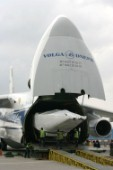 Americas Cup  yacht is loaded onto a Russian transport plane to be air freighted