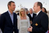 VALENCIA, SPAIN - May 14th: Ernesto Bertarelli (left) owner of the Defender Alinghi and his wife Kirsten meet HRH Prince Albert of Monaco at the exclusive Tuiga Party during the Louis Vuitton Cup Semi Finals.