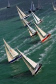 COWES, ENGLAND - August 13th: The fleet of nearly 300 racing yachts leaves Cowes on the Isle of Wight to begin the 605 mile Rolex Fastnet Race on August 13th 2007. The yachts race to the Fastnet Rock off southern Ireland and back to the finish in Plymouth, England