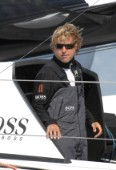 COWES, ENGLAND - August 13th: Alex Thompson on the Open 60 Hugo Boss (UK)  Rolex Fastnet Race 2007