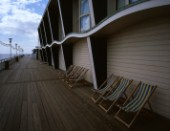 Scene at Bournemouth Pier with deckchairs ready to accept customers, once it warms up.