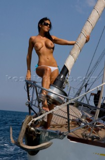 Topless woman on a boat