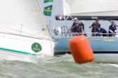 COWES, UK - July 1st: The French racing yacht Saga is hit from astern at the leeward mark on Day 2 of the Rolex Commodores Cup held in Cowes, Isle of Wight. The English Team take the overall lead from the French Blue Team who presently hold second place. The Rolex Commodores Cup is held biannually in the UK and is the premier team racing event in the UK for big racing yachts. It is run by the Royal Ocean Racing Club. (Photo by Mike Jones/kospictures.com).