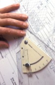 Yacht designer and naval architect tools of the trade set square on drawing board