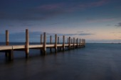 Dusk over a wooden jetty