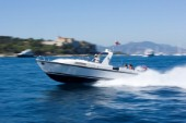 Tender speeding to the superyacht Leander