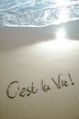 Cest La Vie its life sign writing message on a sandy beach in Tarifa, Spain, near Gibraltar.