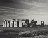 Sunrise at Stonehenge, World Heritage site. Dawn light bathes the standing stones. The site is fenced off and access to the stones is rigorously controlled by English Heirtage. Limited Edition prints available.