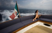 A romantic couple relaxing onboard a Vicel 72 classic motor yacht. Model Released.