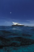 Fairline Phantom 43 at anchor in clear shallow water