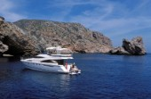 A luxurious Fairline Squadron 58 at rest in a tranquil bay in Majorca