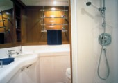 Luxury interior bathroom and shower room of a Swan 80 maxi yacht