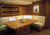Luxury interior saloon and dining table area of a Swan 80 maxi yacht