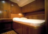Luxury interior guest stateroom and double bed on a Swan 80 maxi yacht
