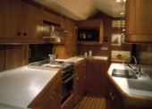 Luxury interior of galley and kitchen on a large maxi Swan yacht