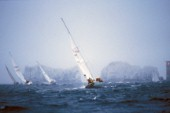 Yachts racing towards The Needles off the Isle of Wight, in stormy conditions