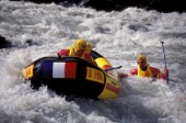 Man falling from inflatable raft whilst White Water Rafting