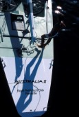 Crew member standing on stern of Americas Cup yacht Australia II