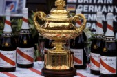 The Admirals Cup  surrounded by bottles of Champagne Mumm