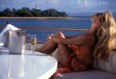 Model Jilly Johnson relaxing on board the superyacht Antilles drinking chilled champagne