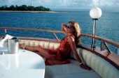 Woman relaxing on deck of superyacht