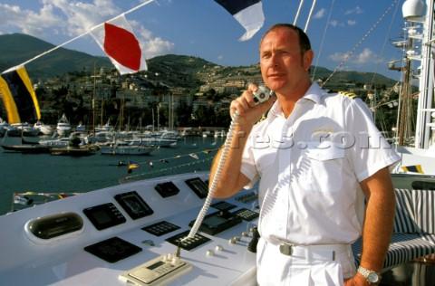Yacht captain using VHF radio  Yacht Captain Uniform