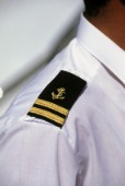 Detail of ship officers epaulette on shoulder