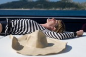 Woman sunbathing on a powerboat