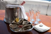 Champagne and oysters onboard a superyacht