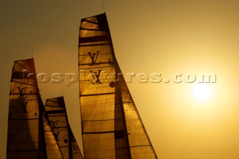 LOUIS VUITTON TROPHY DUBAI UNITED ARAB EMIRATES NOVEMBER 20TH 2010 Sails of the IACC yachts at sunse