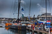 Dockside. Abu Dhabi with the class winner flag.  Rolex Fastnet Race 2011.