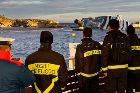 The passenger cruise ship Costa Concordia hit rocks and ran aground at 945pm on the Island of Giglio