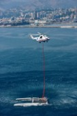 Russian helicopter lifts and transfers the multihull catamaran Alinghi 5 from Lake Geneva to Genoa on the Mediterranean