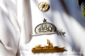 Pins badges and awards or merit on a sailors uniform  The Tall Ships Races 2007 Mediterranea in Genova. Guayas (Ecuador)