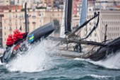 Naples (Italy), 11/04/2012  Americas Cup World Series Naples 2012  Artemis Racing leaps from a wave on Day 1