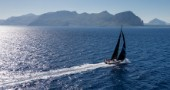 SFS II, Sail n: FRA 1953, Boat Type: VOR 70, Skipper: Lionel Pean, Country: France passing  San Vito lo Capo