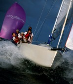 Melges sportsboat boat powers off wave