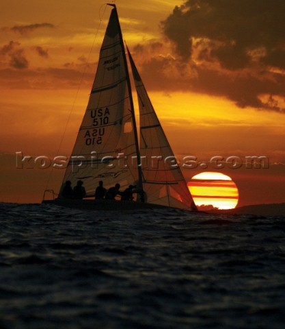 Melges 24 racing in the sunset
