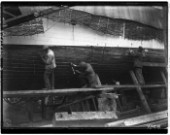 Caulking the hull of a boat at Nicholsons in Gosport in 1930