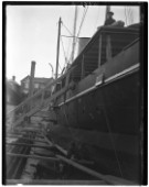 Yacht in dry dock having the hull painted in Marvins Yard on south coast UK in 1930